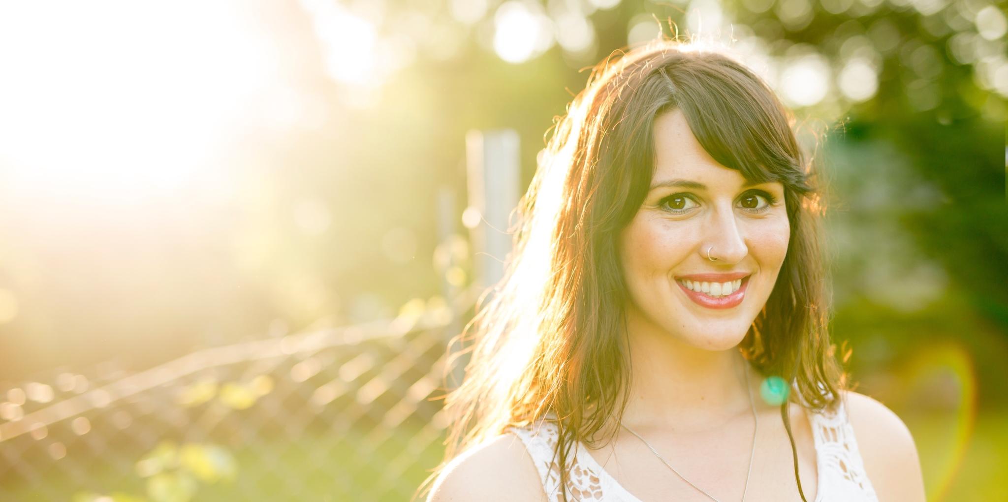 Girl Smiling in Sunshine